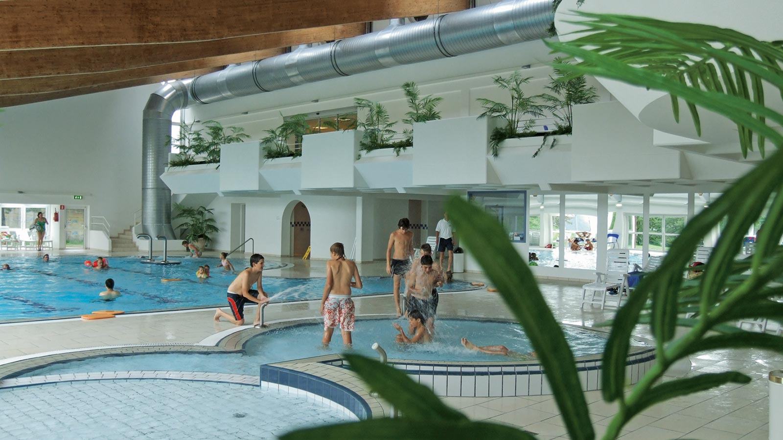 View of the inside of the indoor pool Alpinpool in Maranza with kids playing in the water