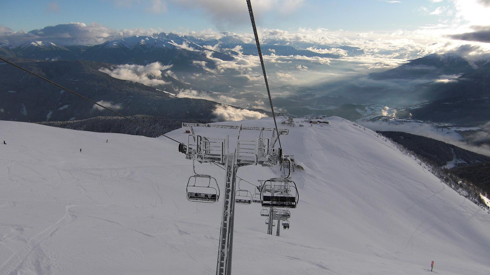 Chair lift in the area of the Gitschberg-Jochtal in winter with lots of snow around