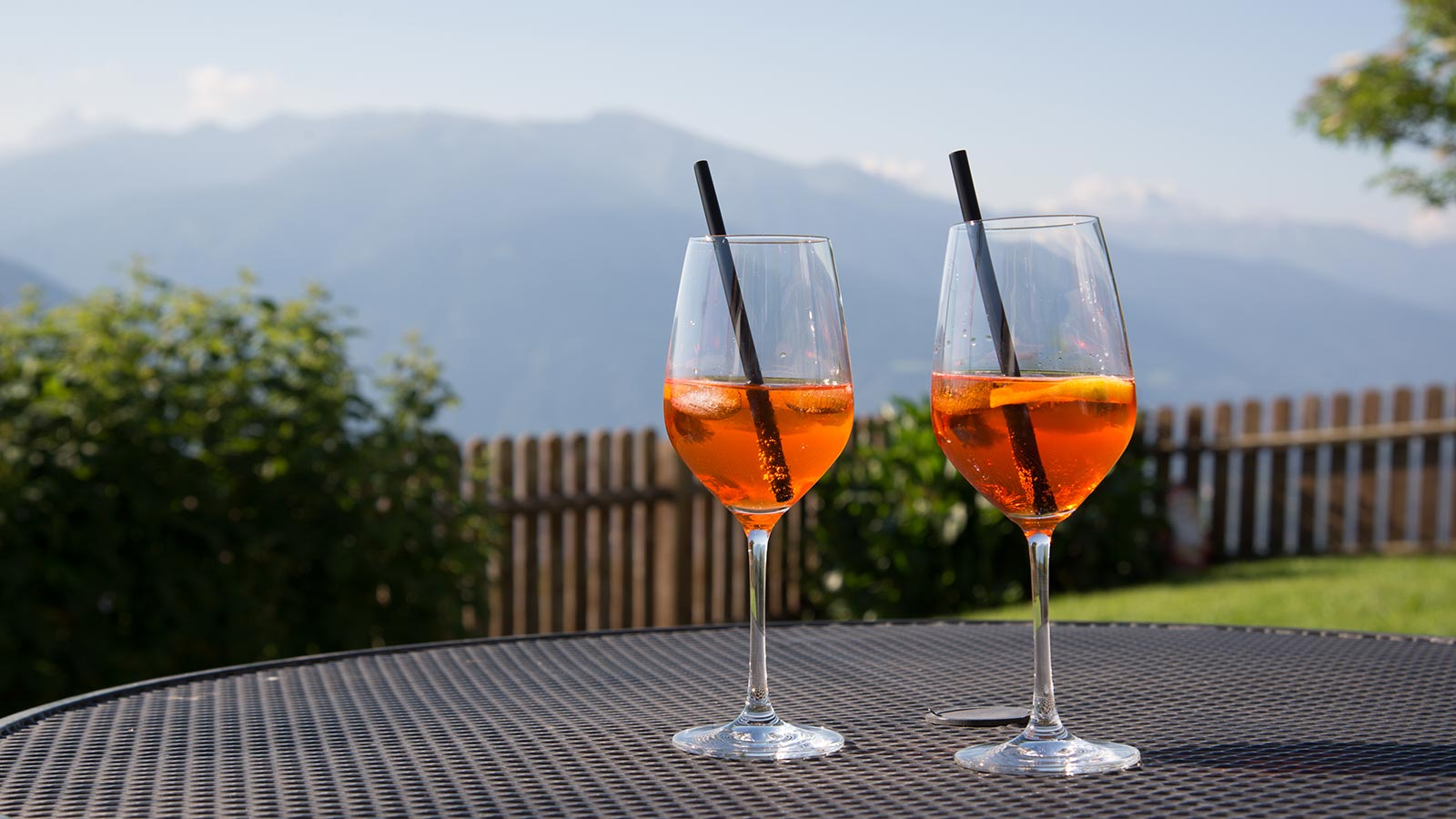 Aperitif in the foreground on a table on the terrace of the Wiesenrain