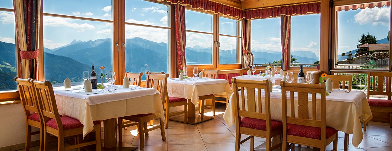 The dining room in the Pensione Wiesenrain with big windows and wonderful view of the mountains around Maranza